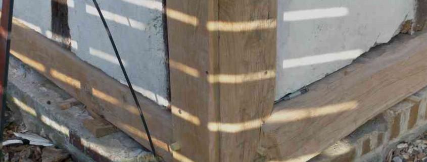 Greffe sur poteau d'angle d'un pan de bois